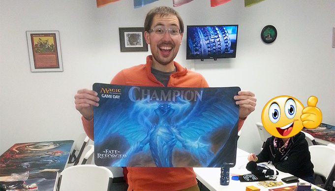 Patrick Merrill holding the Fate Reforged Game Day Playmat